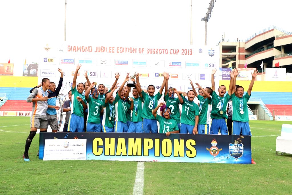 New Delhi: The Sub-Junior U 14 Boys team of Saidan Secondary School, Mizoram after defeating the team of Unique Model Academy, Manipur in Subroto Cup International Football tournament, in New Delhi on Aug 29, 2019. (Photo: IANS) - Academy