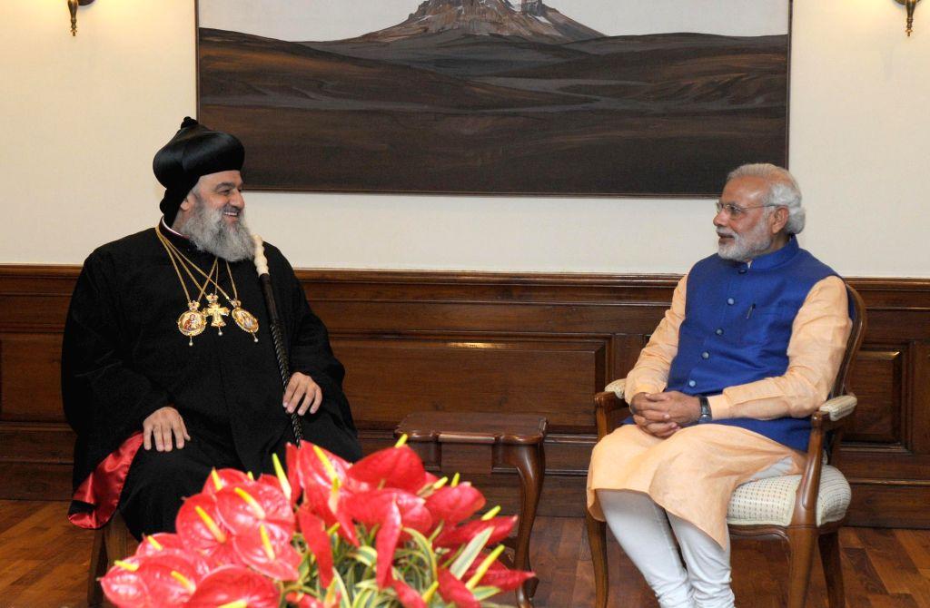 The Supreme Head of the Universal Syrian Orthodox Church H.H. Moran Mor Ignatius Aphrem II calls on Prime Minister Narendra Modi, in New Delhi on Feb 17, 2015. - Narendra Modi