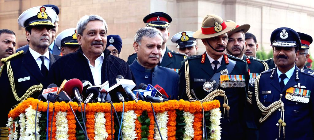 The Union Minister for Defence, Manohar Parrikar interacting with the media after pay homage to the Martyrs of 1971 War, at Amar Jawan Jyoti, to mark Vijay Diwas, in New Delhi on Dec. 16, . - Rao Inderjit Singh and Dalbir Singh