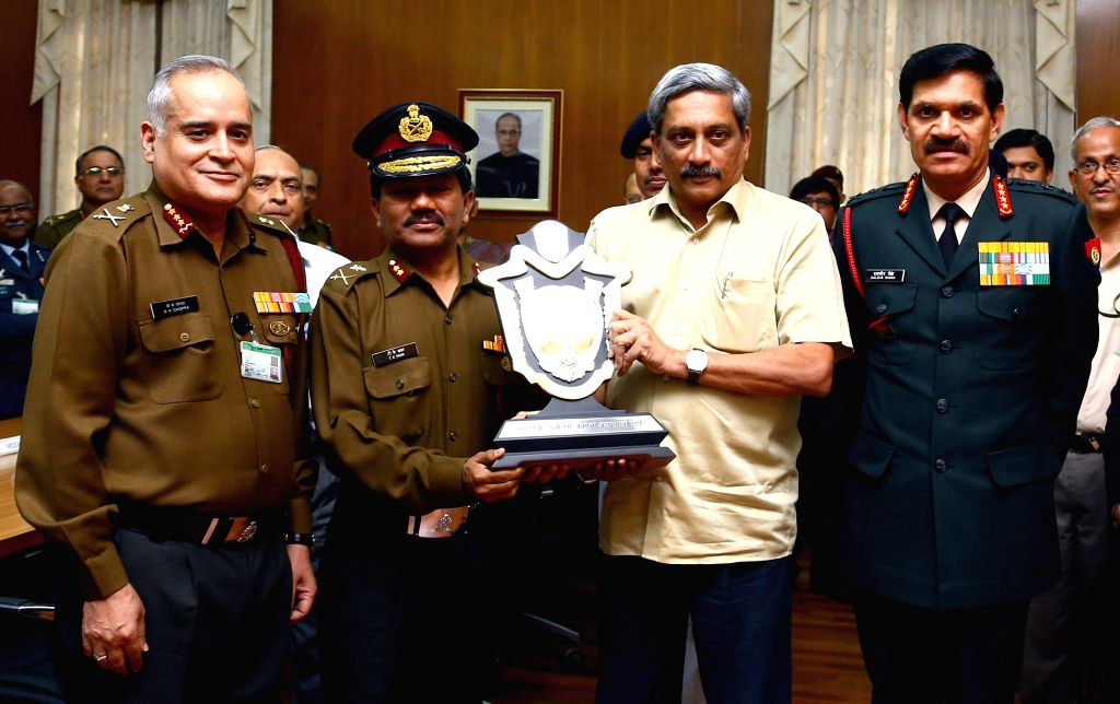 The Union Minister for Defence Manohar Parrikar presents the Raksha Mantri`s Trophy and citation for the Best Service Hospital to Command Hospital (SC), Pune, in New Delhi on Feb 26, 2015. ...
