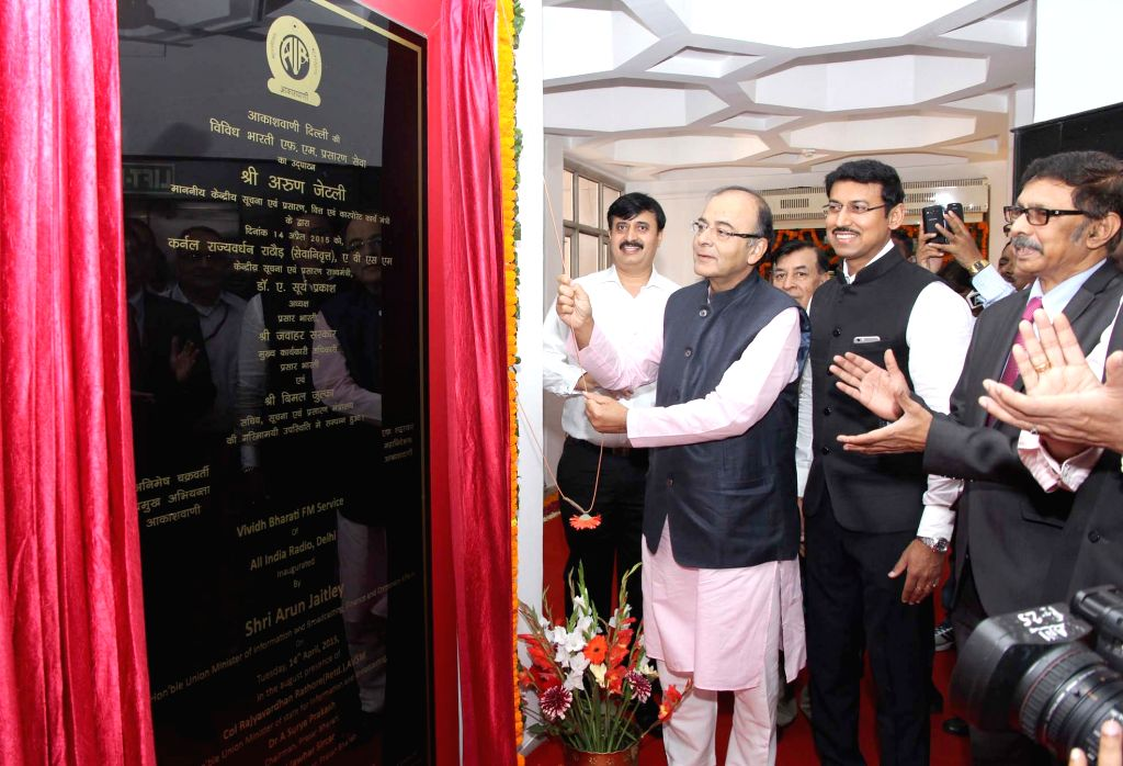 The Union Minister for Finance, Corporate Affairs and Information and Broadcasting, Arun Jaitley unveil the plaque to inaugurate the Vividh Bharati Service on FM (100.1MHz), in New Delhi ... - Rajyavardhan Singh Rathore
