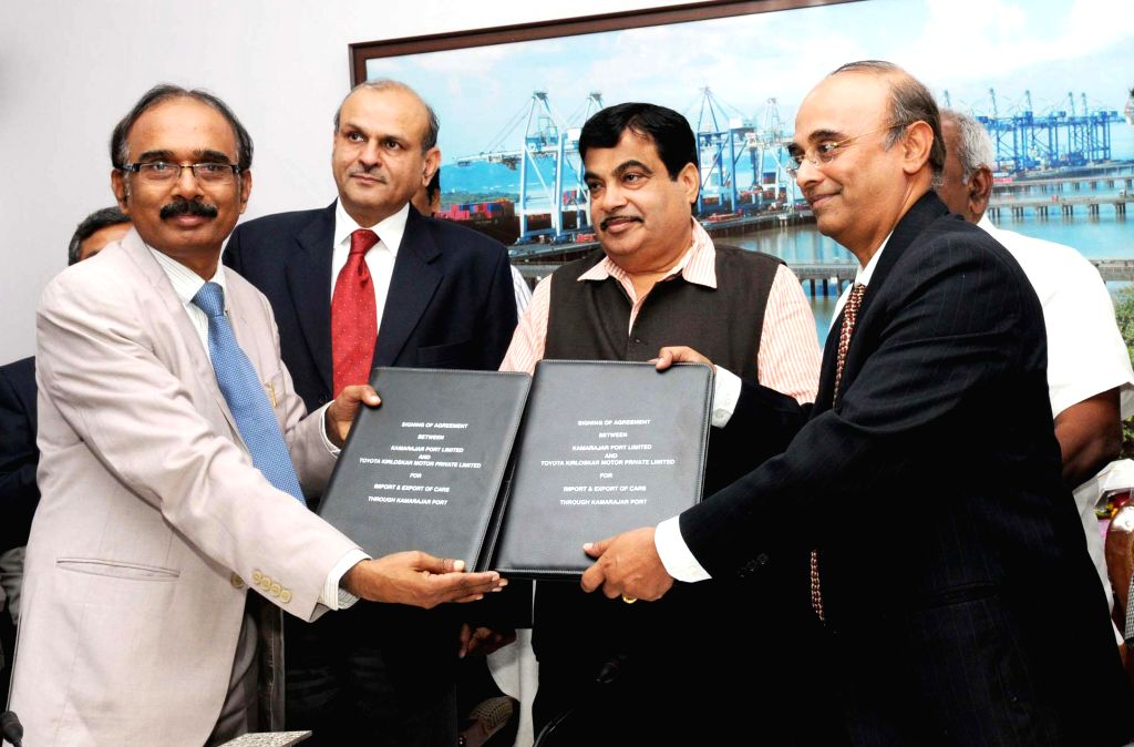 The Union Minister for Road Transport and Highways, and Shipping  and BJP leader Nitin Gadkari witnesses the signing of the agreements between Kamarajar Port Ltd. and Toyota Kirloskar ...