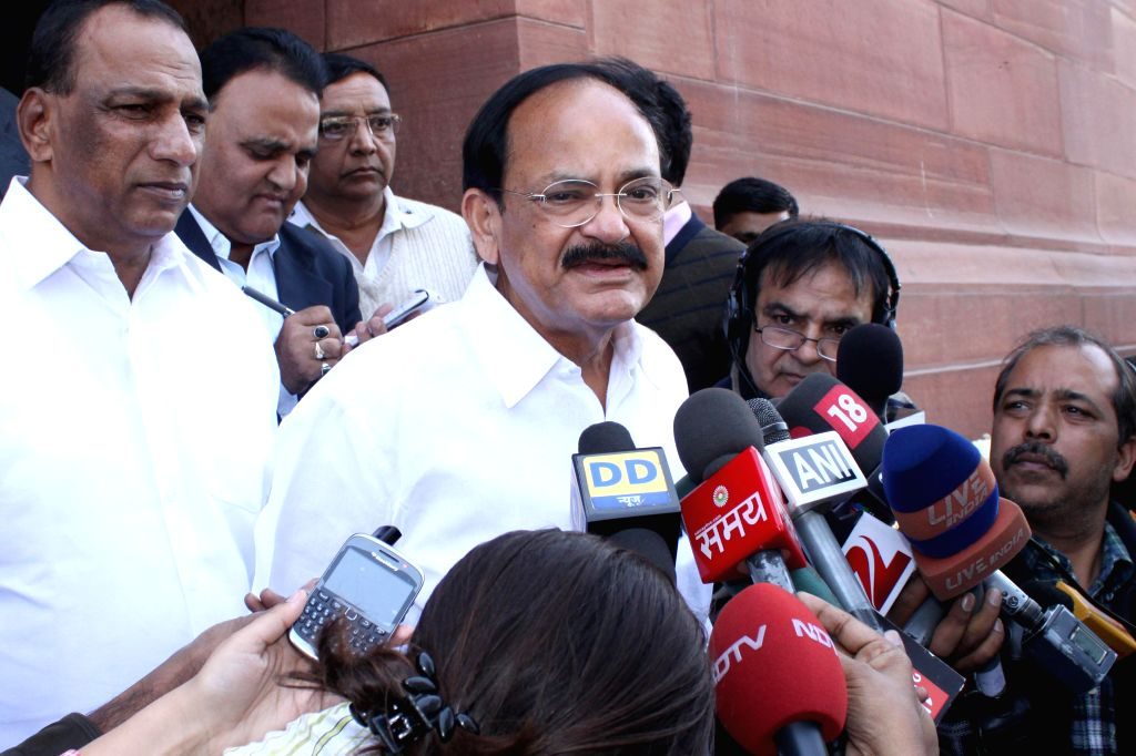 The Union Minister for Urban Development, Housing and Urban Poverty Alleviation and Parliamentary Affairs, M. Venkaiah Naidu addresses press at the Parliament premises in New Delhi, on Dec - M. Venkaiah Naidu