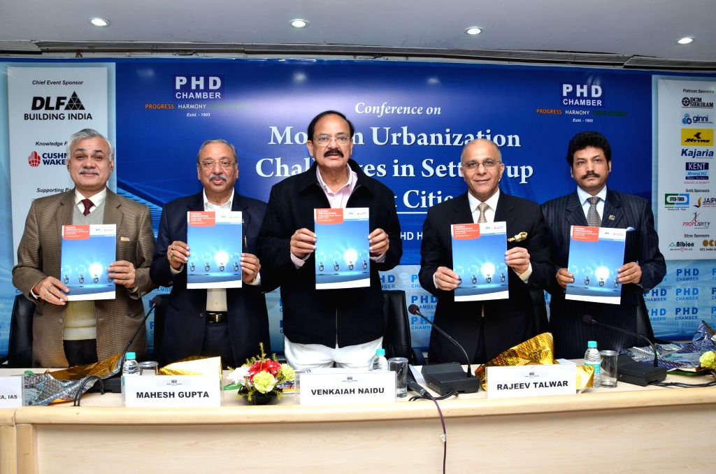 The Union Minister for Urban Development, Housing and Urban Poverty Alleviation and Parliamentary Affairs, M. Venkaiah Naidu at the launch of a report on smart cities in New Delhi, on Jan . - M. Venkaiah Naidu and Mahesh Gupta