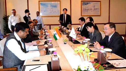 The Union Minister of State for Petroleum and Natural Gas (Independent Charge) Dharmendra Pradhan and the Minister of Economy, Trade and Industry, Japan, Yoichi Miyazawa, during a ...