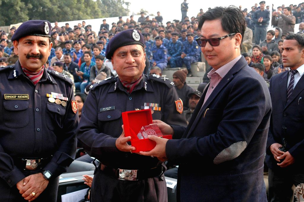 The Union Minister of State for Home Affairs Kiren Rijiju being presented a memento by the  Director General, National Disaster Response Force (NDRF), O.P. Singh at the National Disaster . - P. Singh