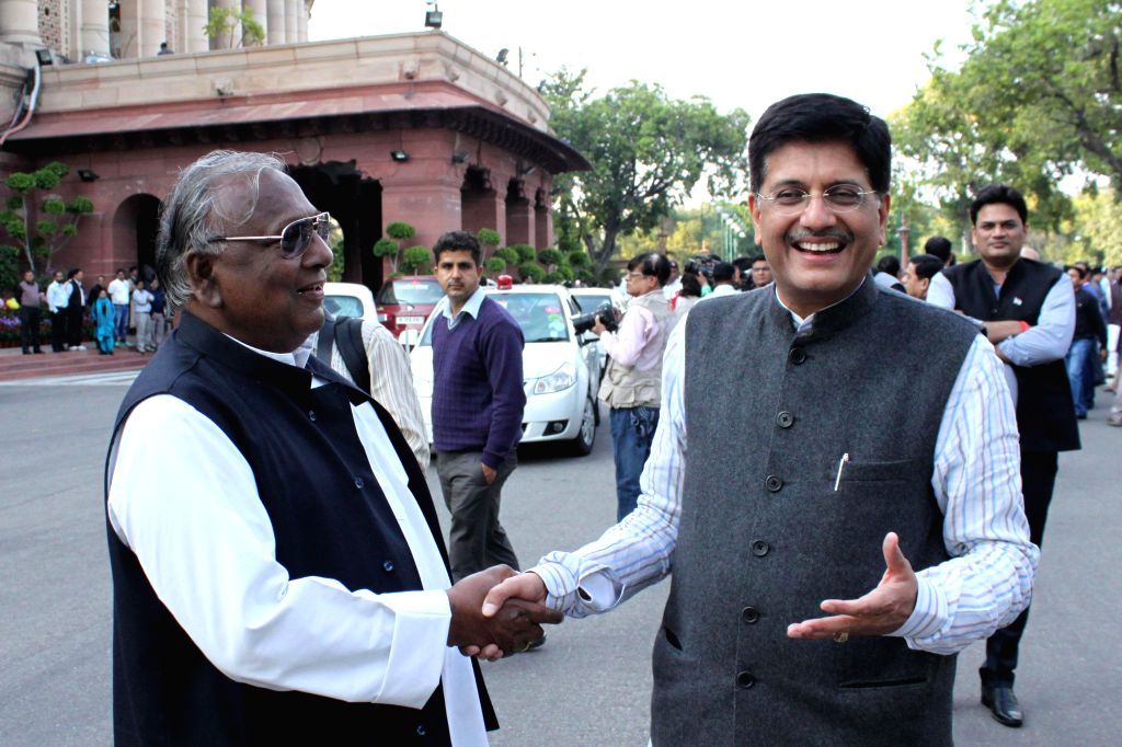 The Union Minister of State (Independent Charge) for Power, Coal and New and Renewable Energy Piyush Goyal with the leader of the Congress parliamentary party in Lok Sabha Mallikarjun ...