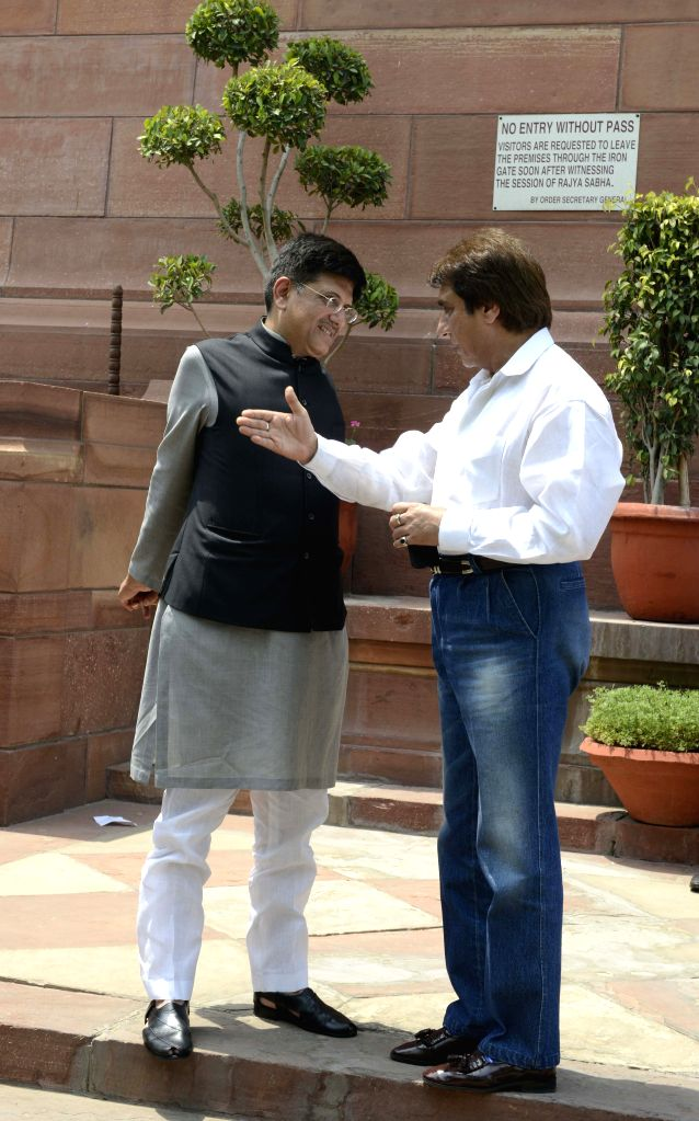 The Union Minister of State (Independent Charge) for Power, Coal and New & Renewable Energy Piyush Goyal with Congress leaders Raj Babbar at the Parliament in New Delhi on May 5, 2015.