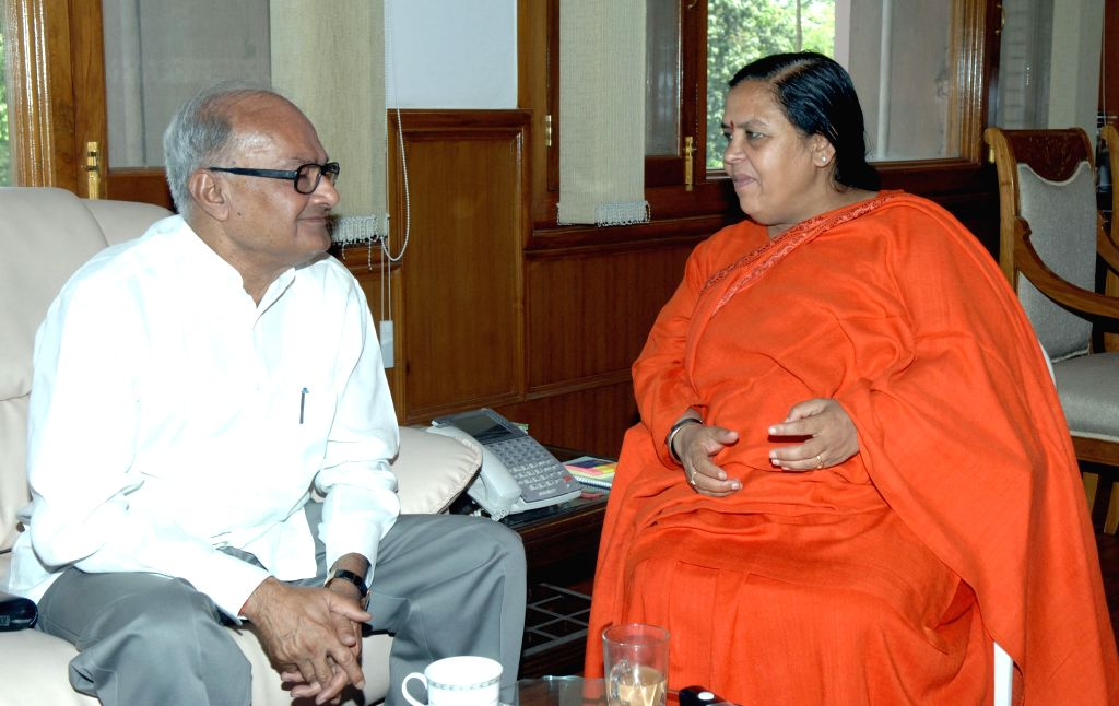 The Water Resources Minister of Madhya Pradesh, Jayant Malaiya calls on the Union Minister for Water Resources, River Development and Ganga Rejuvenation Uma Bharti, in New Delhi on April ...