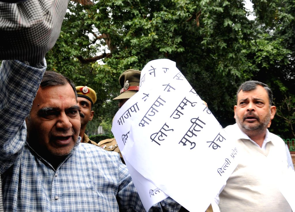 The workers of Jammu and Kashmir National Panthers Party (JKNPP) stage a demonstration against BJP-PDP alliance, in front of BJP headquarters in New Delhi on March 1, 2015.