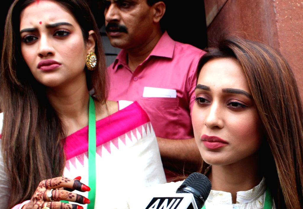 New Delhi: TMC MPs Mimi Chakraborty and Nusrat Jahan, who took oath as the members of Lok Sabha today, talk to media personnel at Parliament in New Delhi on June 25, 2019. (Photo: Amlan Paliwal/IANS) - Mimi Chakraborty