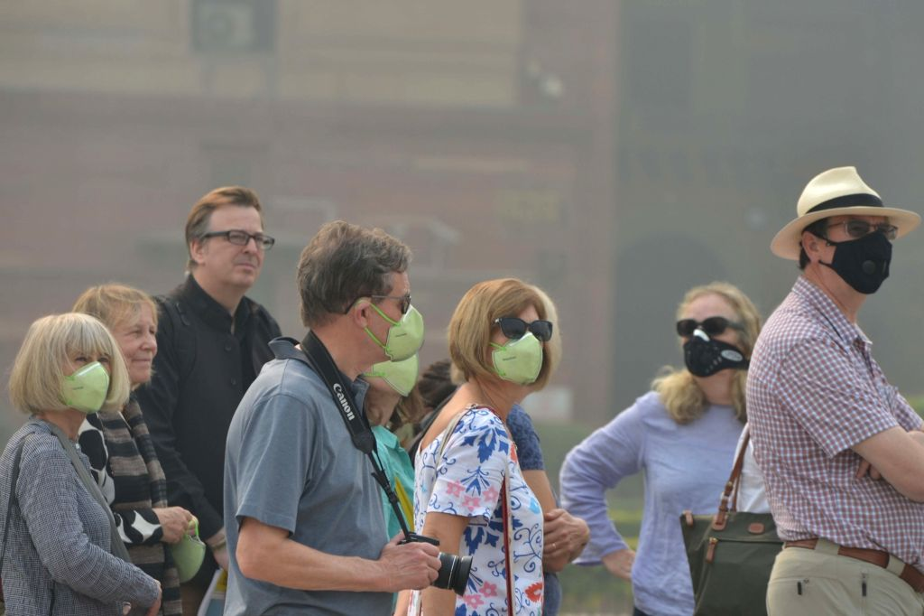 New Delhi: Tourists wear masks to protect themselves from air pollution as toxic haze continues to engulf the national capital, on Nov 13, 2019. The Delhi air quality index (AQI) is at emergency levels again on Wednesday with an overall count of 476
