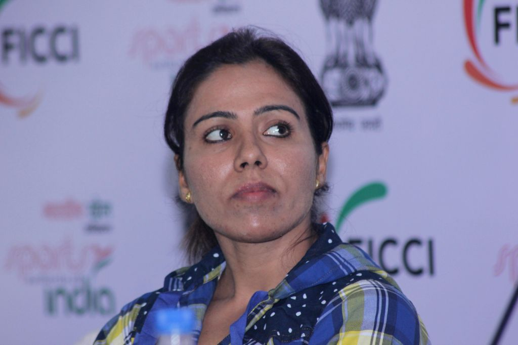 Track and field athlete Priyanka Pawar, who won gold in the 2014 Asian Games during a programme organised by FICCI in New Delhi, on Nov 7, 2014.