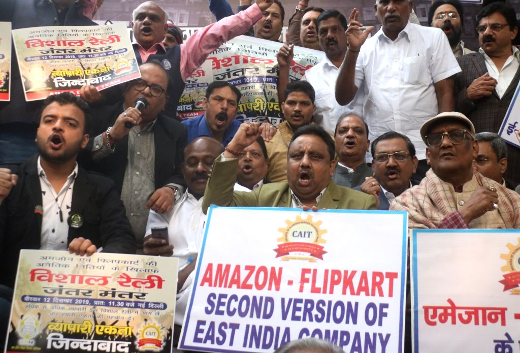 """New Delhi: Traders stage a demonstration against the """"unethical and unfair trade practices"""" of e-commerce firms Flipkart and Amazon, at Jantar Mantar in New Delhi on Dec 12, 2019. (Photo: IANS)"""