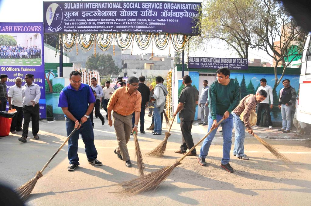 New Delhi: Trainee Officers of the Indian Foreign Service posted in different countries with school children and locals participates at a `Clean India Campaign` during their visit at the Sulabh complex in New Delhi, on Feb 21, 2015. (Photo: IANS)