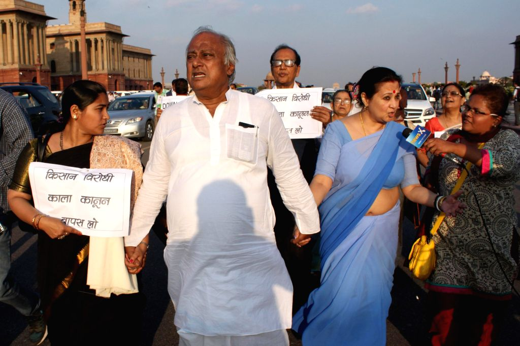 Trinamool Congress leader Saugata Roy and others participate in a march to the Rashtrapati Bhawan to protest against the controversial land acquisition bill in New Delhi, on March 17, ... - Saugata Roy and Sonia Gandhi