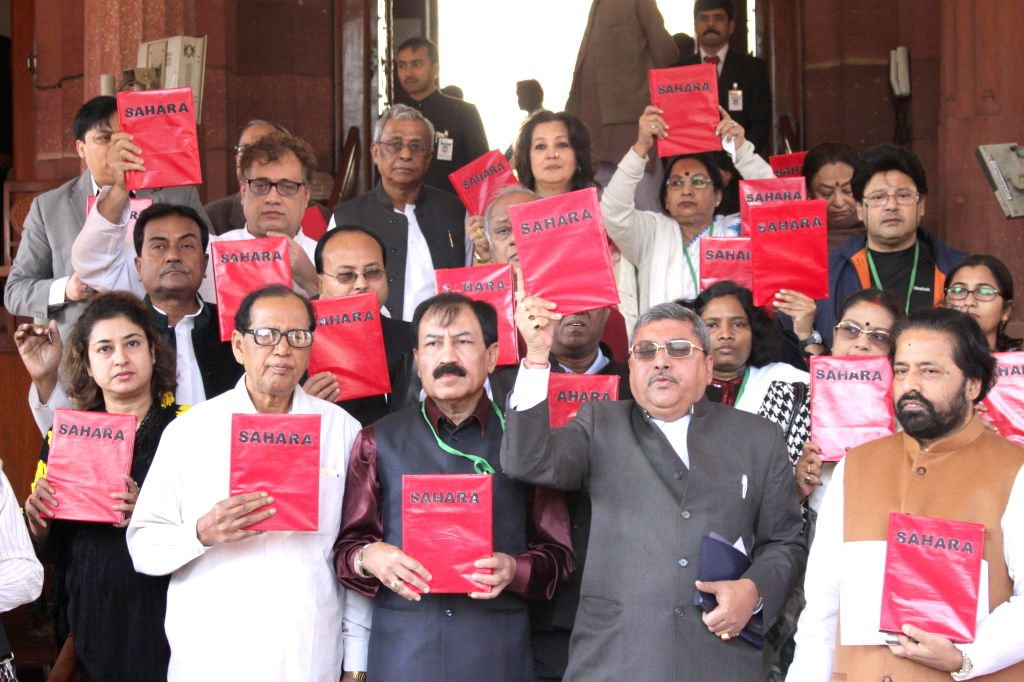 Trinamool Congress MPs stage a demonstration at the Parliament premises in New Delhi, on Dec 1, 2014.