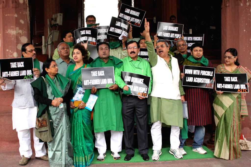 Trinamool Congress MPs stage a demonstration inside the Parliament premises in New Delhi, on Feb 24, 2015.