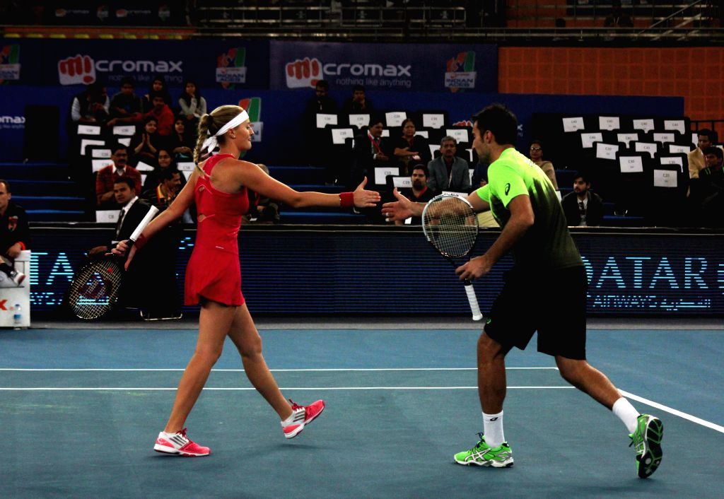 UAE Royals Nenad Zimonjic and Kristina Mladenovic in action during their mixed doubles match against Singapore Slammers Nick Kyrgios and Daniela Hantuchova on the Coca-Cola International ..