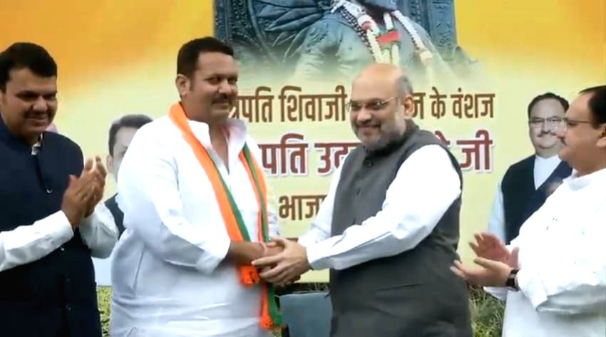 New Delhi: Udayanraje Bhonsle joins BJP in presence of Union Home Minister Amit Shah in New Delhi on Sep 14, 2019. (Photo: IANS) - Amit Shah