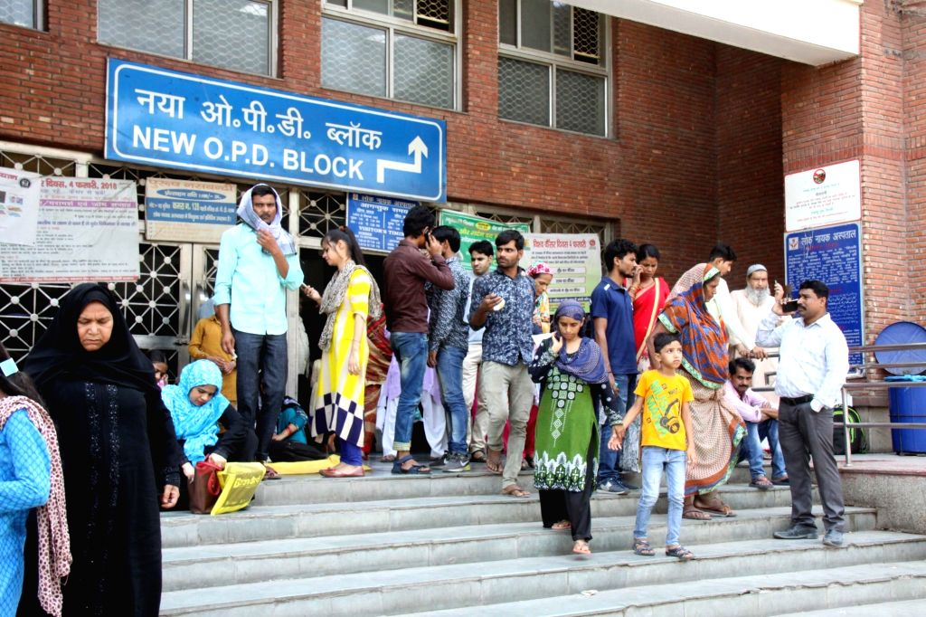 New Delhi: Unattended patients wait outside the OPD block of Loknayak Jayaprakash Narayan (LNJP) hospital where doctors went on a one day token strike and boycotted work to protest against the brutal assault on fellow medicos of West Bengal; in New D