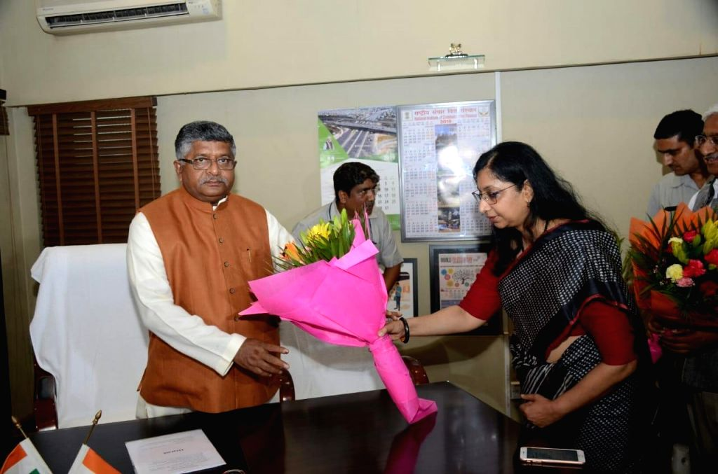 New Delhi: Union Communication Minister Ravi Shankar Prasad being greeted by the ministry's officials after taking charge of office, at Sanchar Bhawan in New Delhi on June 3, 2019. (Photo: IANS/PIB) - Ravi Shankar Prasad