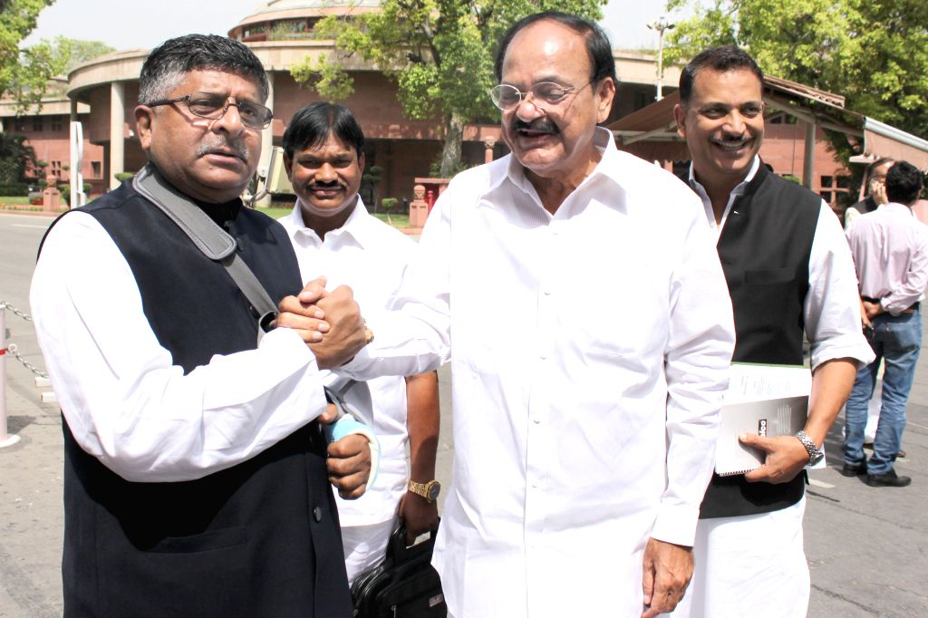 Union Communications and IT Minister Ravi Shankar Prasad with the Union Minister for Urban Development, Housing and Urban Poverty Alleviation and Parliamentary Affairs, M. Venkaiah Naidu ... - Ravi Shankar Prasad and M. Venkaiah Naidu
