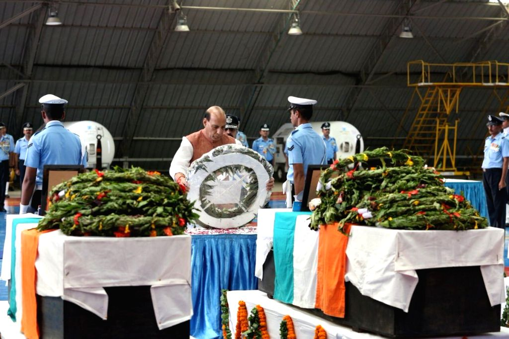 New Delhi: Union Defence Minister Rajnath Singh pays tributes to five of the 13 air-warriors, who lost their lives in the AN-32 crash in Arunachal Pradesh on June 3; at the Palam Technical area in New Delhi on June 21, 2019. (Photo: Twitter/@rajnaths - Rajnath Singh