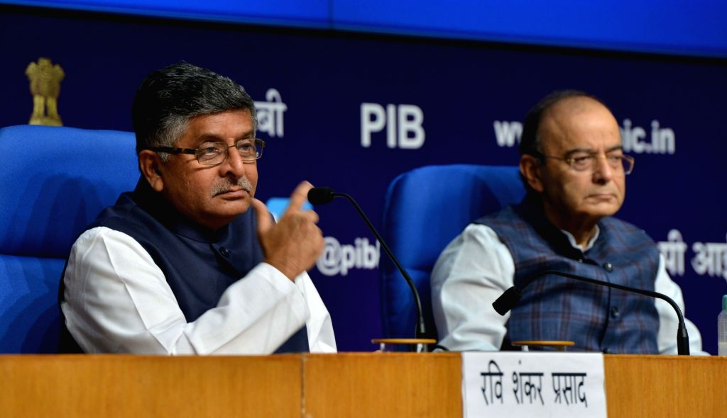 :New Delhi: Union Electronics and Information Technology and Law and Justice Minister Ravi Shankar Prasad addresses during a press conference after a cabinet briefing, along with Union Finance and ...