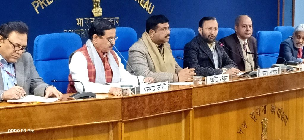 New Delhi: Union Environment, Forest and Climate Change and Information and Broadcasting Minister Prakash Javadekar, Union Petroleum & Natural Gas and Steel Minister Dharmendra Pradhan and Union Parliamentary Affairs Minister Pralhad Joshi at a Cabin - Prakash Javadekar and Pralhad Joshi