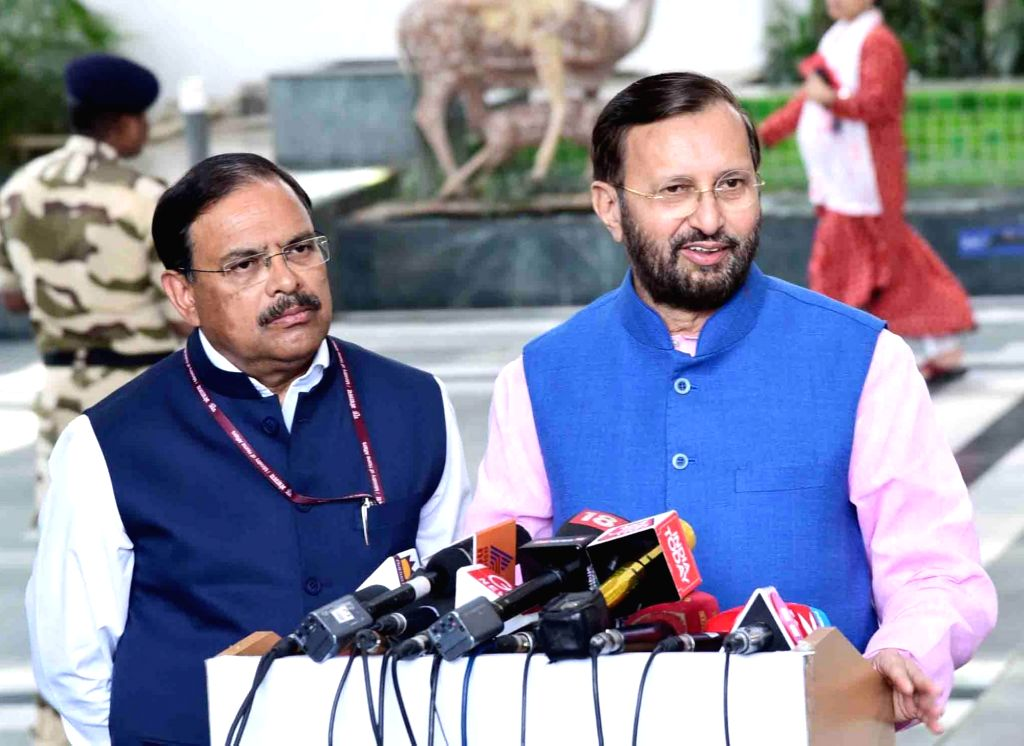 """New Delhi: Union Environment, Forest and Climate Change Minister Prakash Javadekar talks to media persons after launching """"#SelfieWithSapling"""" campaign on the eve World Environment Day, in New Delhi on June 4, 2019. (Photo: IANS/PIB) - Prakash Javadekar"""