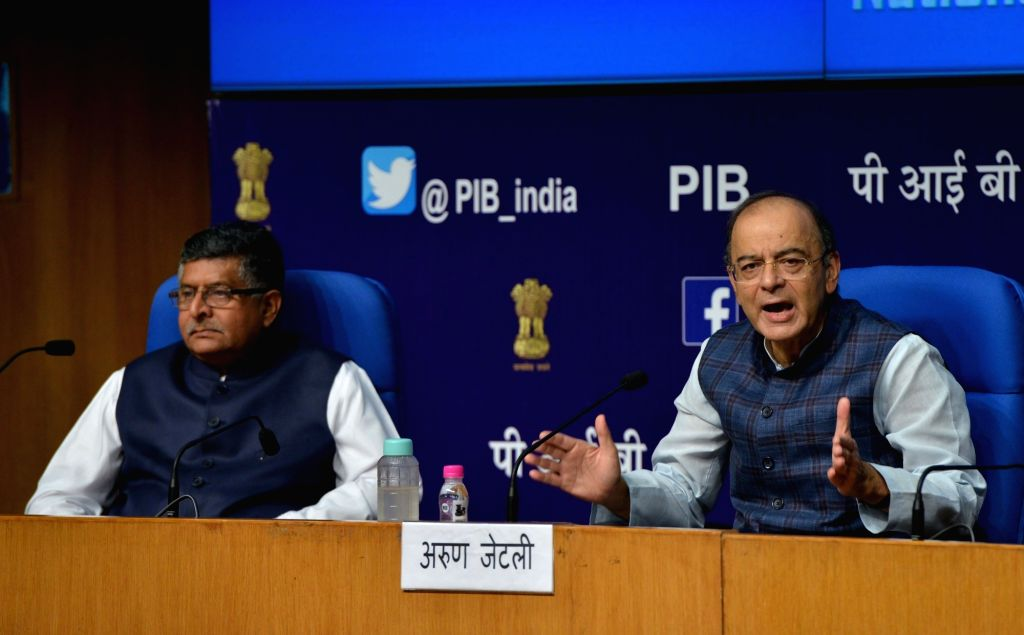 : New Delhi: Union Finance and Corporate Affairs Minister Arun Jaitley addresses during a press conference after a cabinet briefing, along with Union Electronics and Information Technology and Law ...