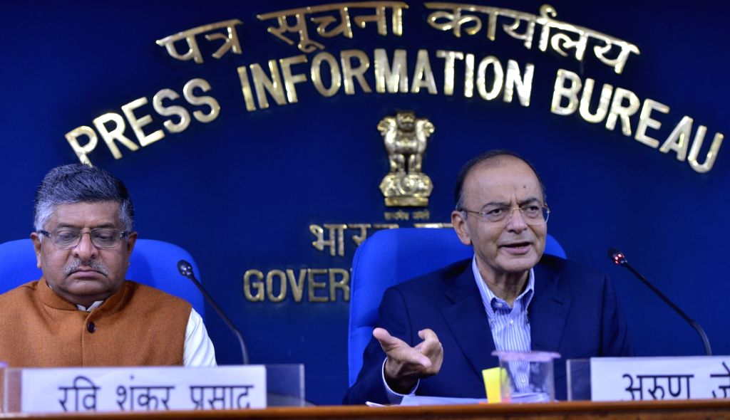 New Delhi: Union Finance and Corporate Affairs Minister Arun Jaitley along with Union Law and Justice Minister Ravi Shankar Prasad addresses a press conference in New Delhi, on March 7, 2019. (Photo: IANS) - Arun Jaitley