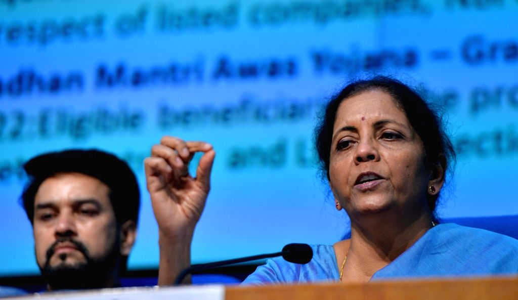 New Delhi: Union Finance and Corporate Affairs Minister Nirmala Sitharaman accompanied by Union MoS Finance and Corporate Affairs Anurag Thakur, addresses a press conference in New Delhi on Sep 14, 2019. (Photo: IANS) - Nirmala Sitharaman