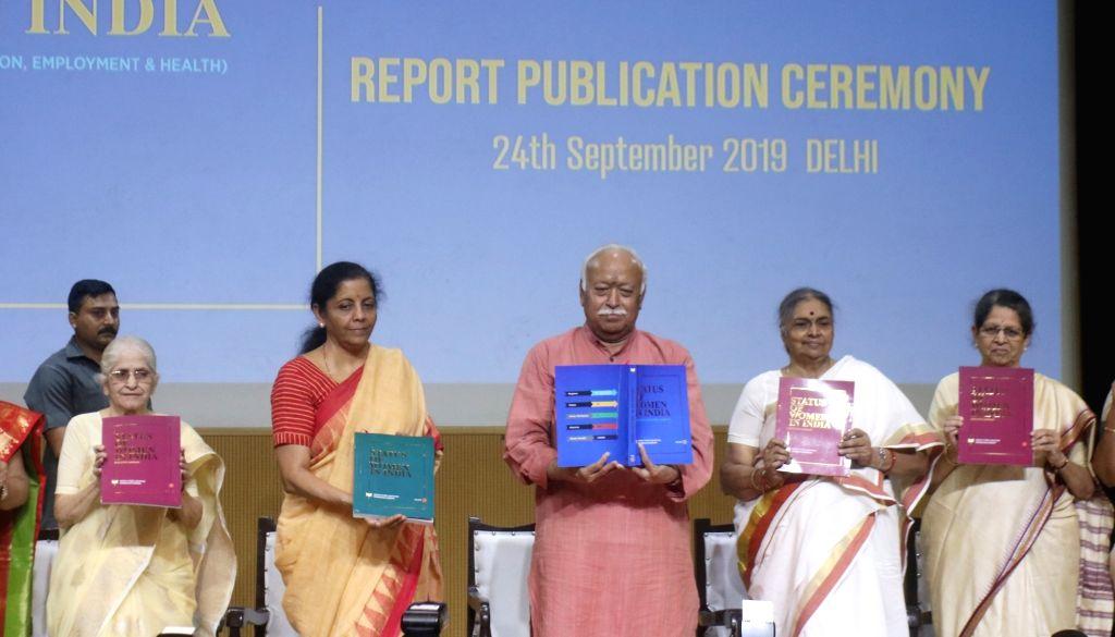 New Delhi: Union Finance and Corporate Affairs Minister Nirmala Sitharaman and Rashtriya Swayamsevak Sangh (RSS) chief Mohan Bhagwat unveil report on Status of Women in India, in New Delhi on Sep 24, 2019. (Photo: IANS) - Nirmala Sitharaman