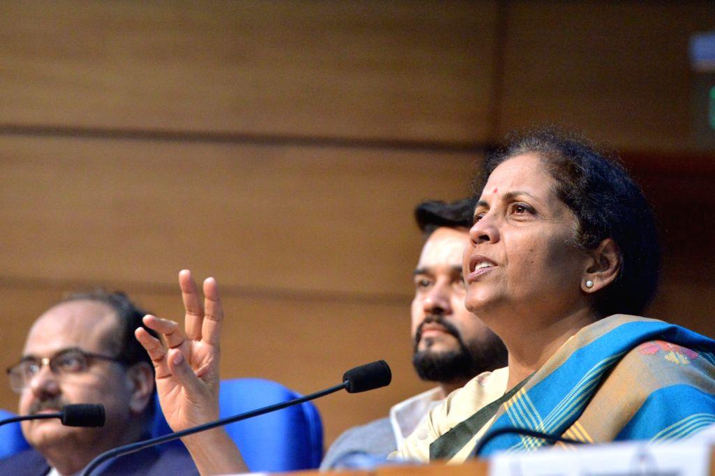 New Delhi: Union Finance and Corporate Affairs Minister Nirmala Sitharaman accompanied by Union MoS Finance and Corporate Affairs Anurag Thakur, addresses a press conference in New Delhi, on Dec 13, 2019. (Photo: IANS) - Nirmala Sitharaman