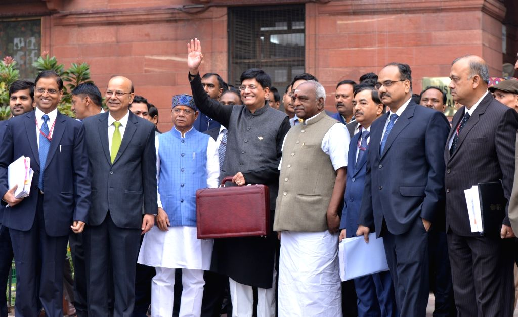 New Delhi: Union Finance and Corporate Affairs Minister Piyush Goyal accompanied by Union Ministers of State for Finance Pon Radhakrishnan and Shiv Pratap Shukla, Economic Affairs Secretary Subhash Chandra Garg, Finance Secretary Ajay Narayan Jha, ou - Piyush Goyal