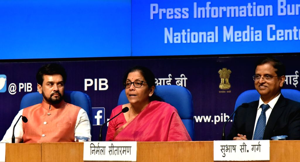New Delhi: Union Finance Minister Nirmala Sitharaman addresses a Post Budget Press Conference, in New Delhi on July 5, 2019. Also seen Union MoS Finance Anurag Singh Thakur and Finance Secretary S.C. Garg. (Photo: IANS/PIB) - Nirmala Sitharaman and Anurag Singh Thakur