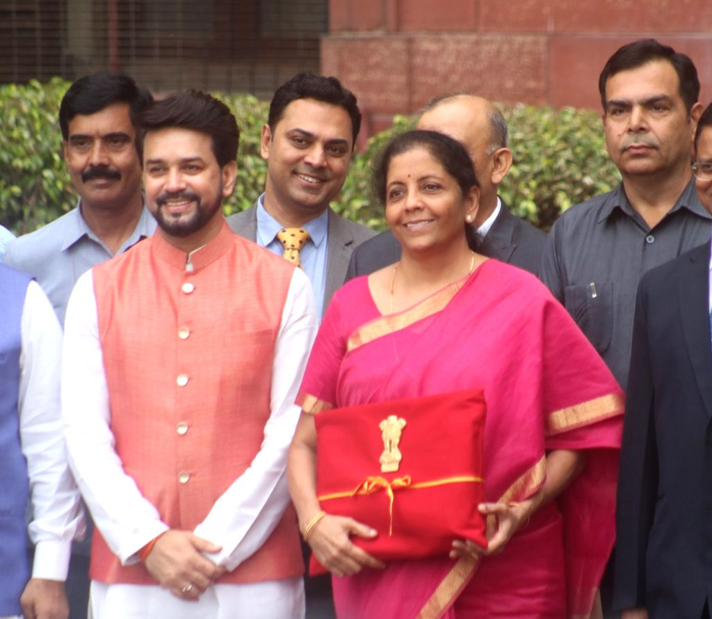 New Delhi: Union Finance Minister Nirmala Sitharaman along with Union Minister of State for Finance Anurag Thakur leaves for Rashtrapati Bhawan from North Block in New Delhi on July 5, 2019. (Photo: Bidesh Manna/IANS) - Nirmala Sitharaman