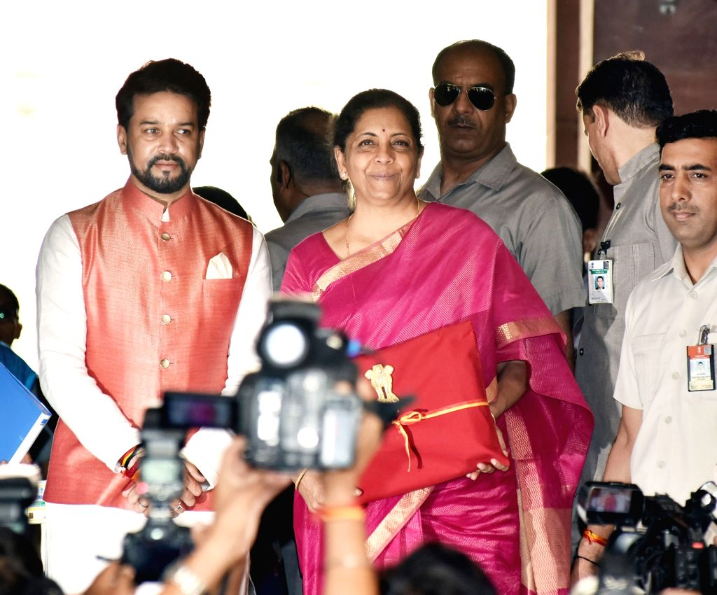 New Delhi: Union Finance Minister Nirmala Sitharaman along with Union Minister of State for Finance Anurag Thakur, arrives at Parliament to present the Union Budget 2019, in New Delhi on July 5, 2019. Setting a new precedent Union Finance Minister Ni - Nirmala Sitharaman