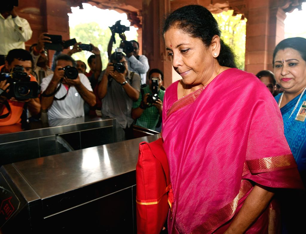New Delhi: Union Finance Minister Nirmala Sitharaman arrives at Parliament to present the Union Budget 2019, in New Delhi on July 5, 2019. Setting a new precedent Union Finance Minister Nirmala Sitharaman on Friday is seen hugging the budget document - Nirmala Sitharaman