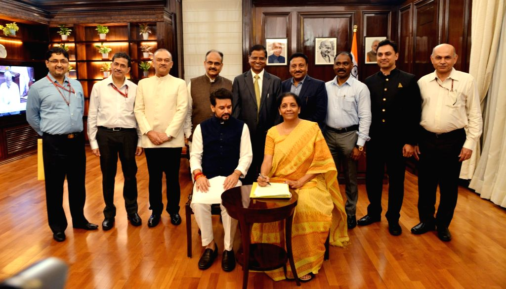 New Delhi: Union Finance Minister Nirmala Sitharaman with MoS Finance Anurag Thakur and team officials pose for a group photo after giving the final touches to the Union Budget 2019-20, in New Delhi on July 4, 2019. (Photo: IANS) - Nirmala Sitharaman