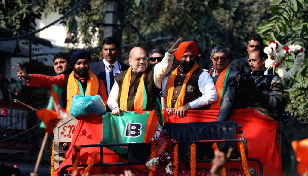New Delhi: Union Home Minister Amit Shah accompanied by BJP's electoral candidate from Hari Nagar Tajinder Pal Singh Bagga, holds a roadshow ahead of February 8 Delhi Assembly elections, in New Delhi on Feb 6, 2020. (Photo: IANS) - Amit Shah