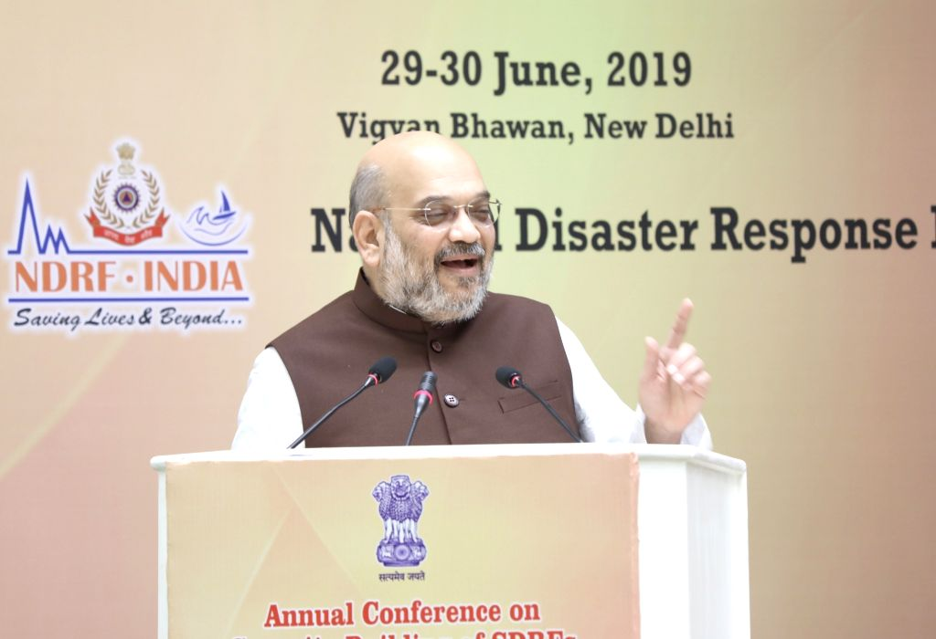 New Delhi: Union Home Minister Amit Shah addresses at the Annual Conference on Capacity Building of SDRFs, Civil Defence, Home Guards and Fire Services organised by the National Disaster Response Force (NDRF) in New Delhi on June 29, 2019. (Photo: IA - Amit Shah