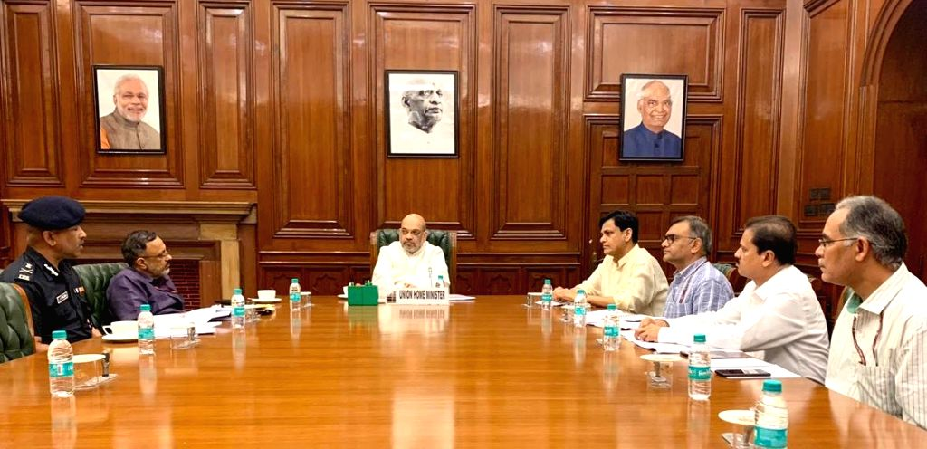 New Delhi: Union Home Minister Amit Shah chairs a high level meeting in New Delhi to review the current flood situation on July 13, 2019. Also seen Minister of State for Home Affairs Nityanand Rai, Home Secretary Rajiv Gauba and other officials. (Pho - Amit Shah and Affairs Nityanand Rai