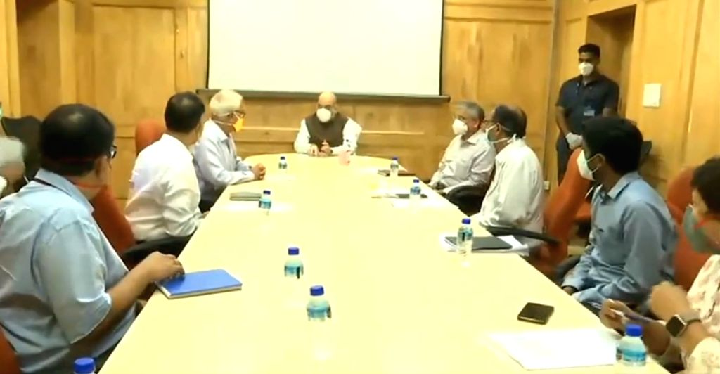 New Delhi: Union Home Minister Amit Shah chairs a meeting to review preparedness for Covid-19 cases during his visit to Delhi's Lok Nayak Jai Prakash (LNJP) Hospital on June 15, 2020. (Photo: IANS) - Amit Shah