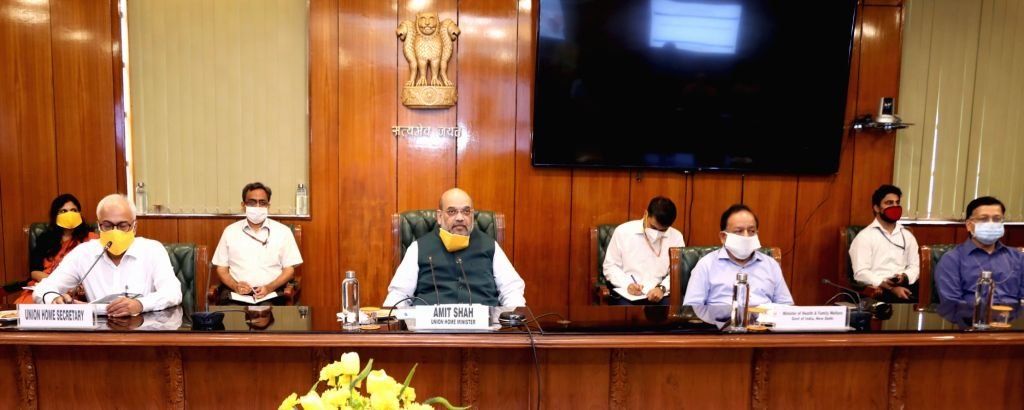 New Delhi: Union Home Minister Amit Shah chairs a meeting to review the situation of COVID19 in the national capital, New Delhi on June 14, 2020. Also present at the meeting were Union Health Minister Harsh Vardhan, Delhi Lt. Governor Anil Baijal, Ch - Amit Shah, Arvind Kejriwal and Satyendra Kumar Jain
