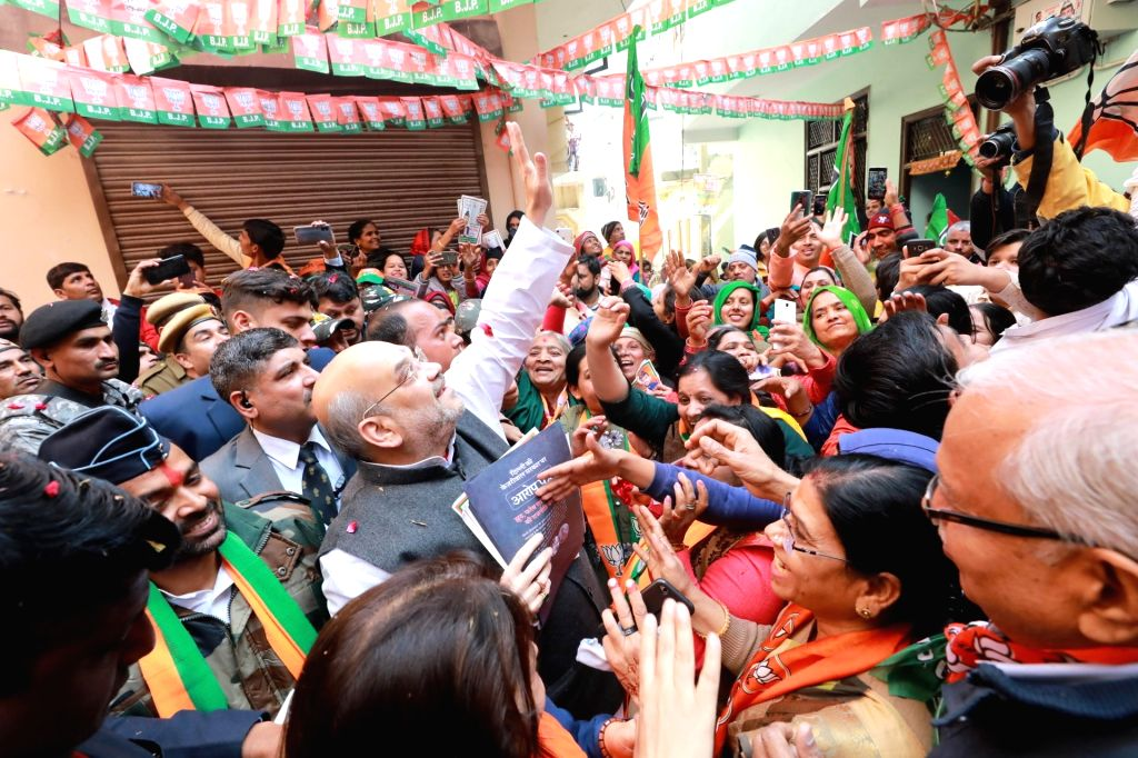 New Delhi: Union Home Minister Amit Shah meets people during the door-to-door campaign 'Jan Sampark Yatra' launched by the BJP ahead of the February 8 Assembly election, at Delhi Cantt area on Feb 2, 2020. (Photo: IANS) - Amit Shah