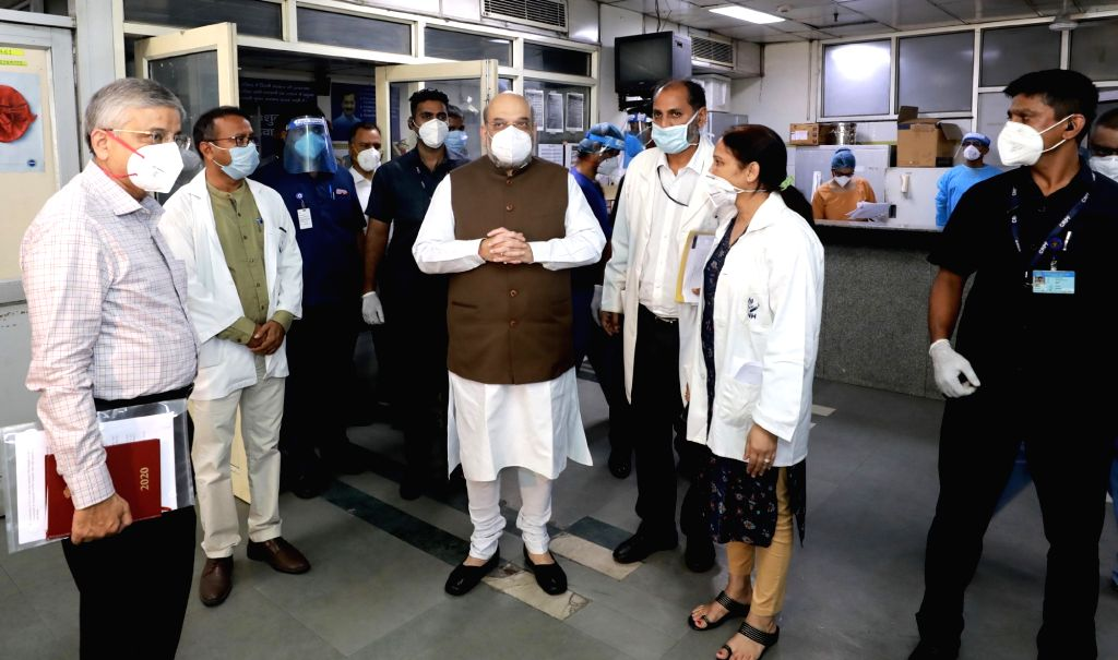 New Delhi: Union Home Minister Amit Shah on a surprise visit to Lok Nayak Jay Prakash Narayan (LNJP) Hospital to review the arrangements related to COVID-19, in New Delhi on June 15, 2020. (Photo: IANS/PIB) - Amit Shah