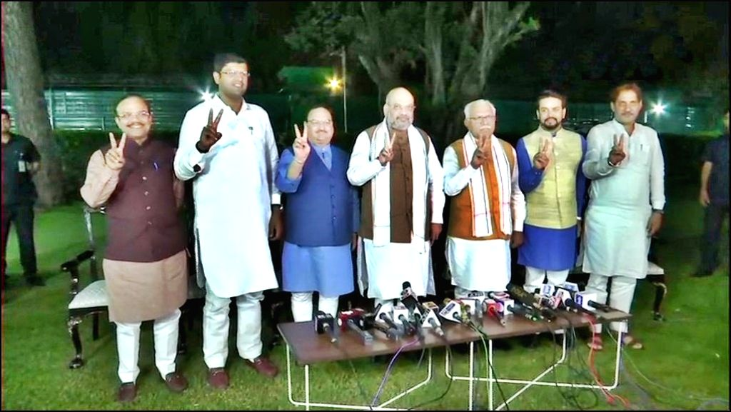 New Delhi: Union Home Minister Amit Shah talks to press regarding the formation of coalition government in Haryana; at his residence in New Delhi on Oct 25, 2019. Also seen BJP working President J P Nadda, Jannayak Janta Party (JJP) chief Dushyant Ch - Amit Shah and Manohar Lal Khattar